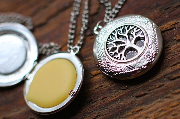 Locket essential oil diffuser on wooden background